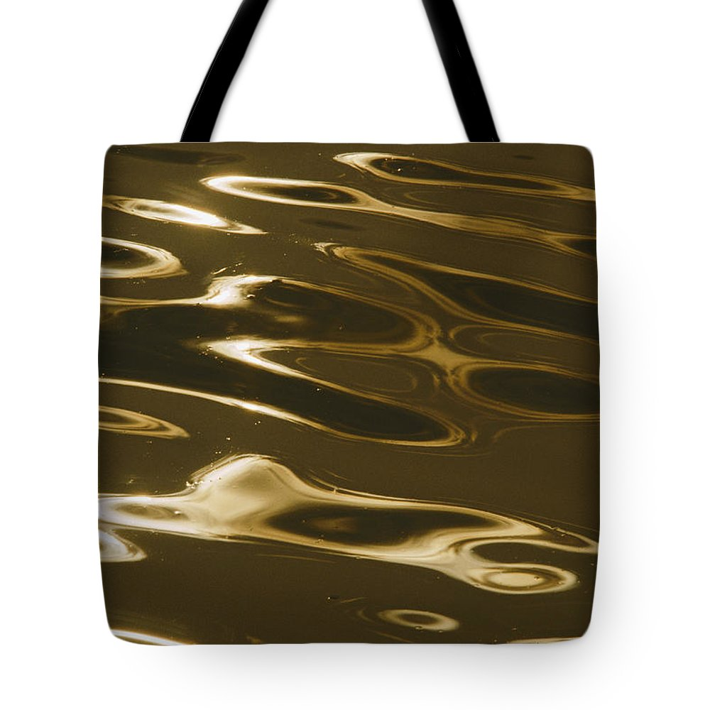 United States Tote Bag featuring the photograph Ripples Of Water Reflect The Setting by Todd Gipstein