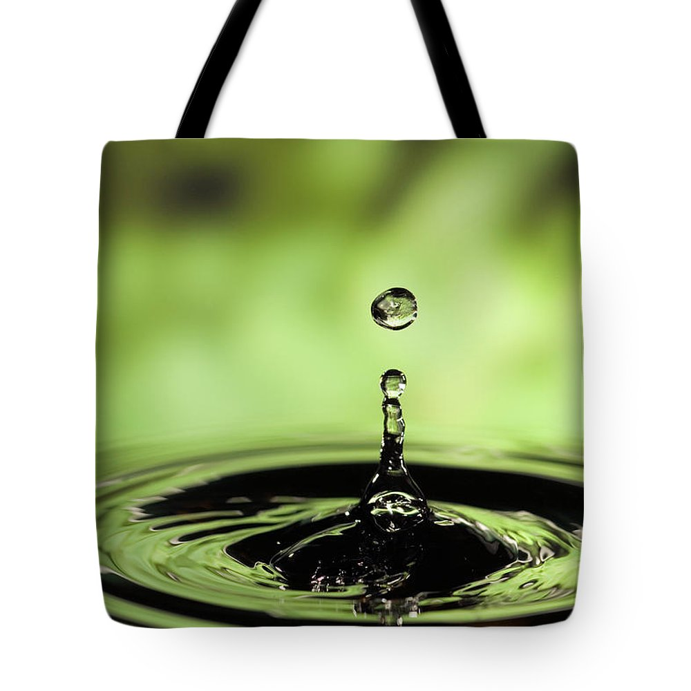 Mp Tote Bag featuring the photograph Ripples Radiating Out From Drop by Michael Durham