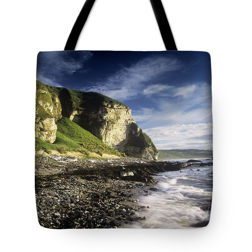 Cliff Tote Bag featuring the photograph Rock Formations At The Coast by The Irish Image Collection
