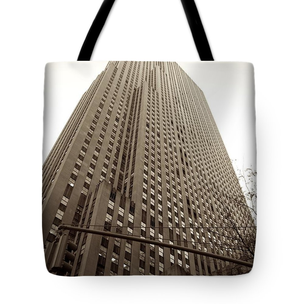 New York City Tote Bag featuring the photograph Rockefeller Center In Sepia by Eric Tressler