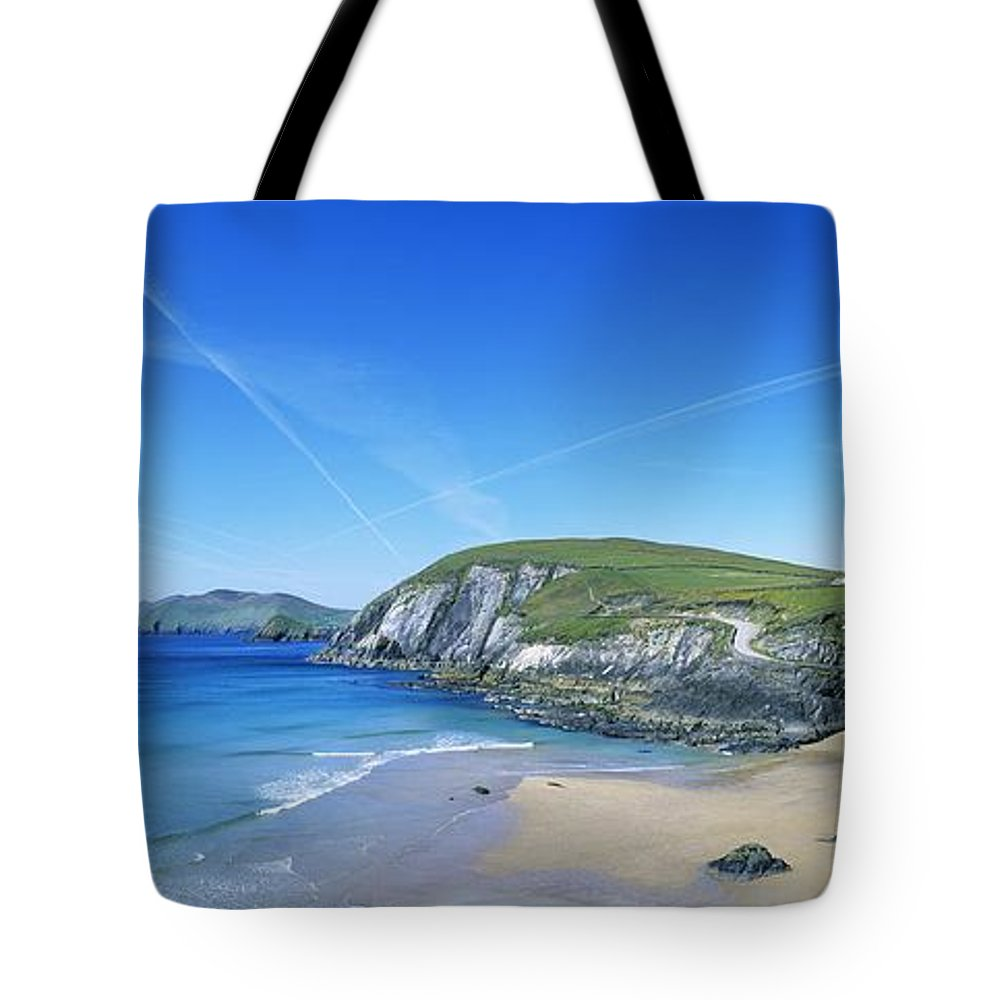 Blasket Islands Tote Bag featuring the photograph Rocks On The Beach, Coumeenoole Beach by The Irish Image Collection