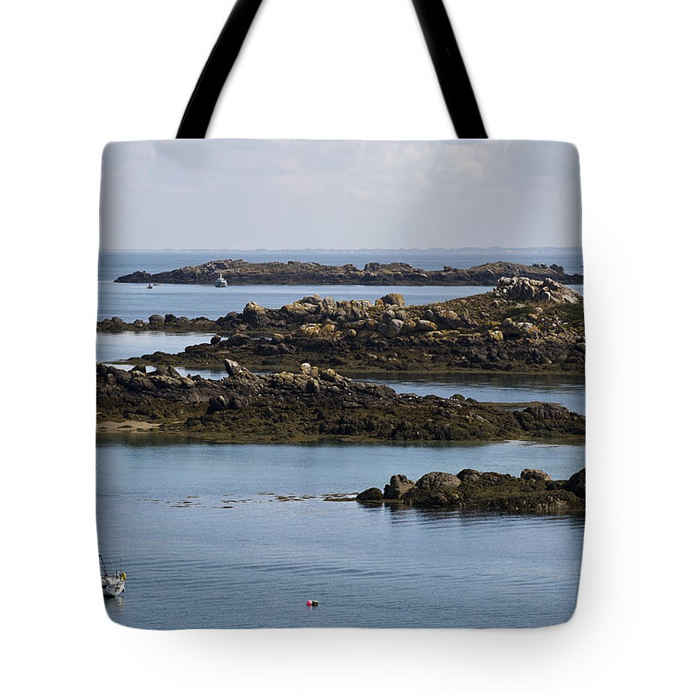 Normandy Tote Bag featuring the photograph Rocky Moorings Iles Chausey by Gary Eason