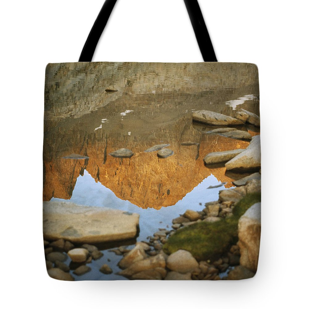 Color Image Tote Bag featuring the photograph Rocky Mountain Peaks Are Reflected by Gordon Wiltsie