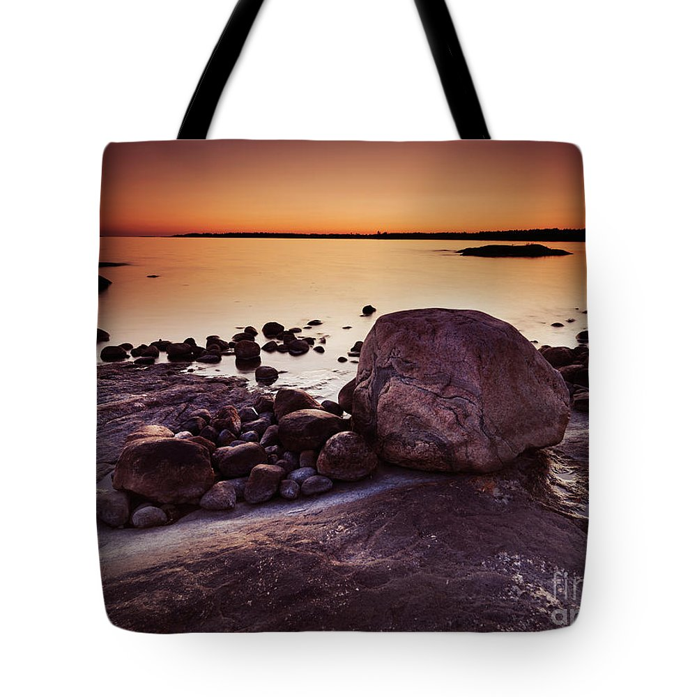 Nature Tote Bag featuring the photograph Rocky Shore At Twilight by Oleksiy Maksymenko