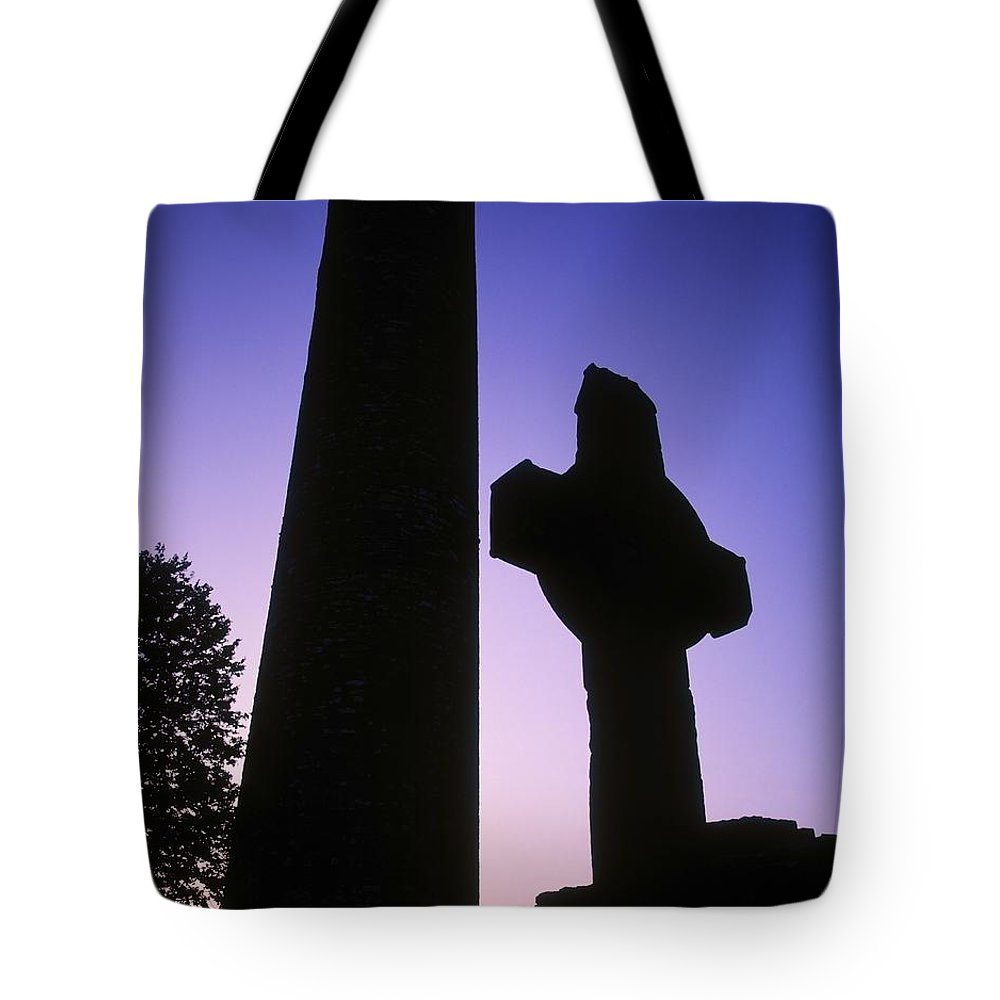 Ancient Tote Bag featuring the photograph Round Tower And High Cross by The Irish Image Collection