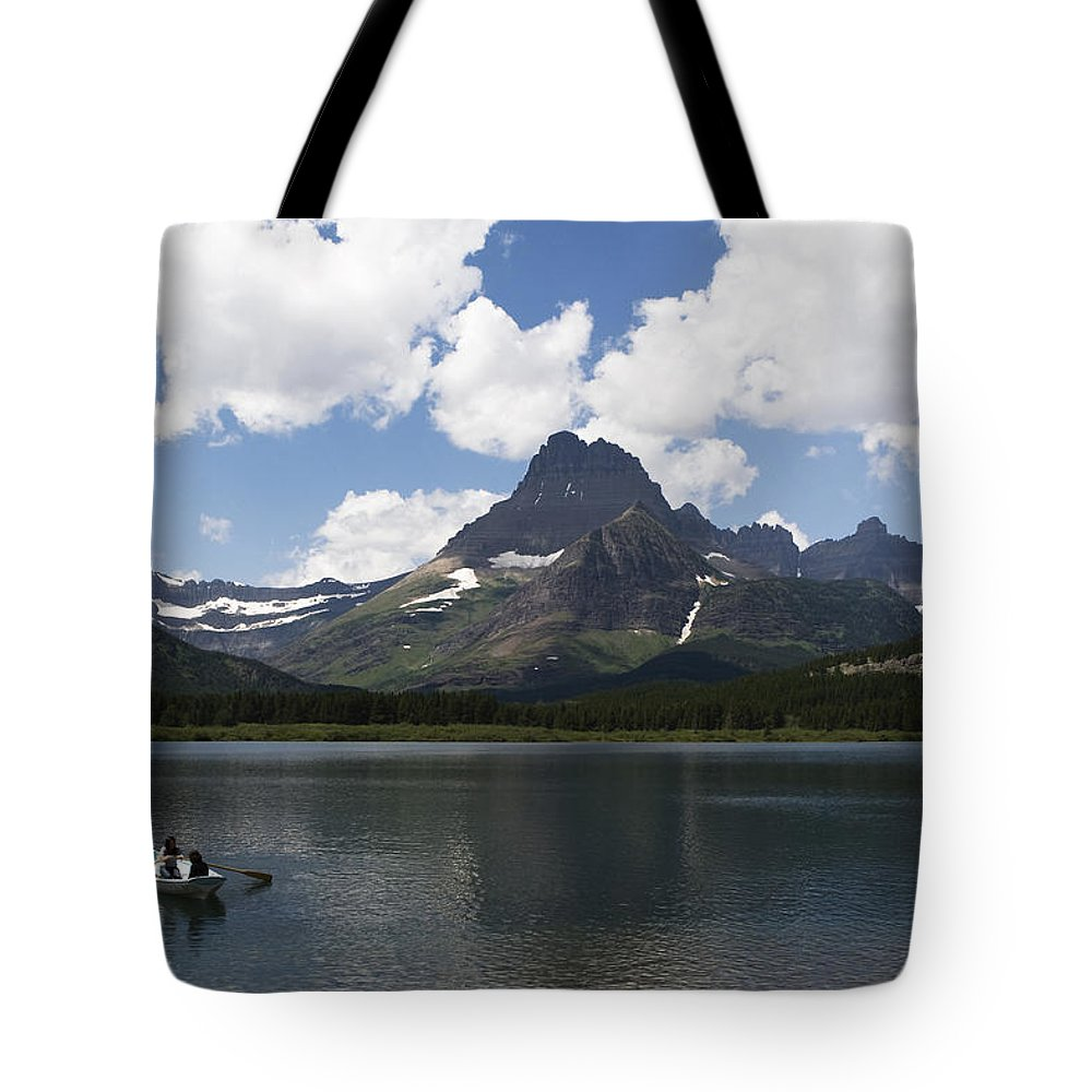 Rowboat Tote Bag featuring the photograph Rowboat At Many Glacier by Lorraine Devon Wilke