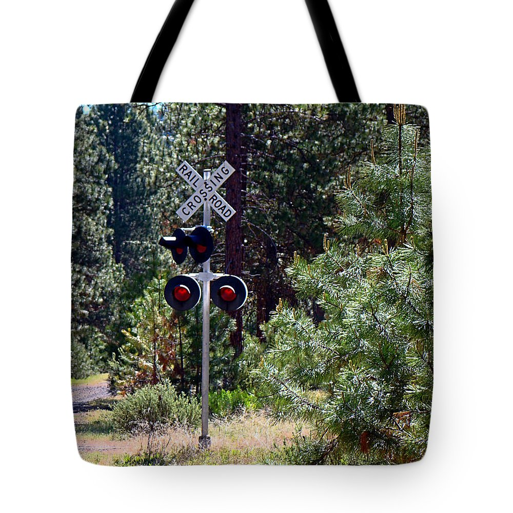 Signal Tote Bag featuring the photograph Rural Crossing by Nick Kloepping