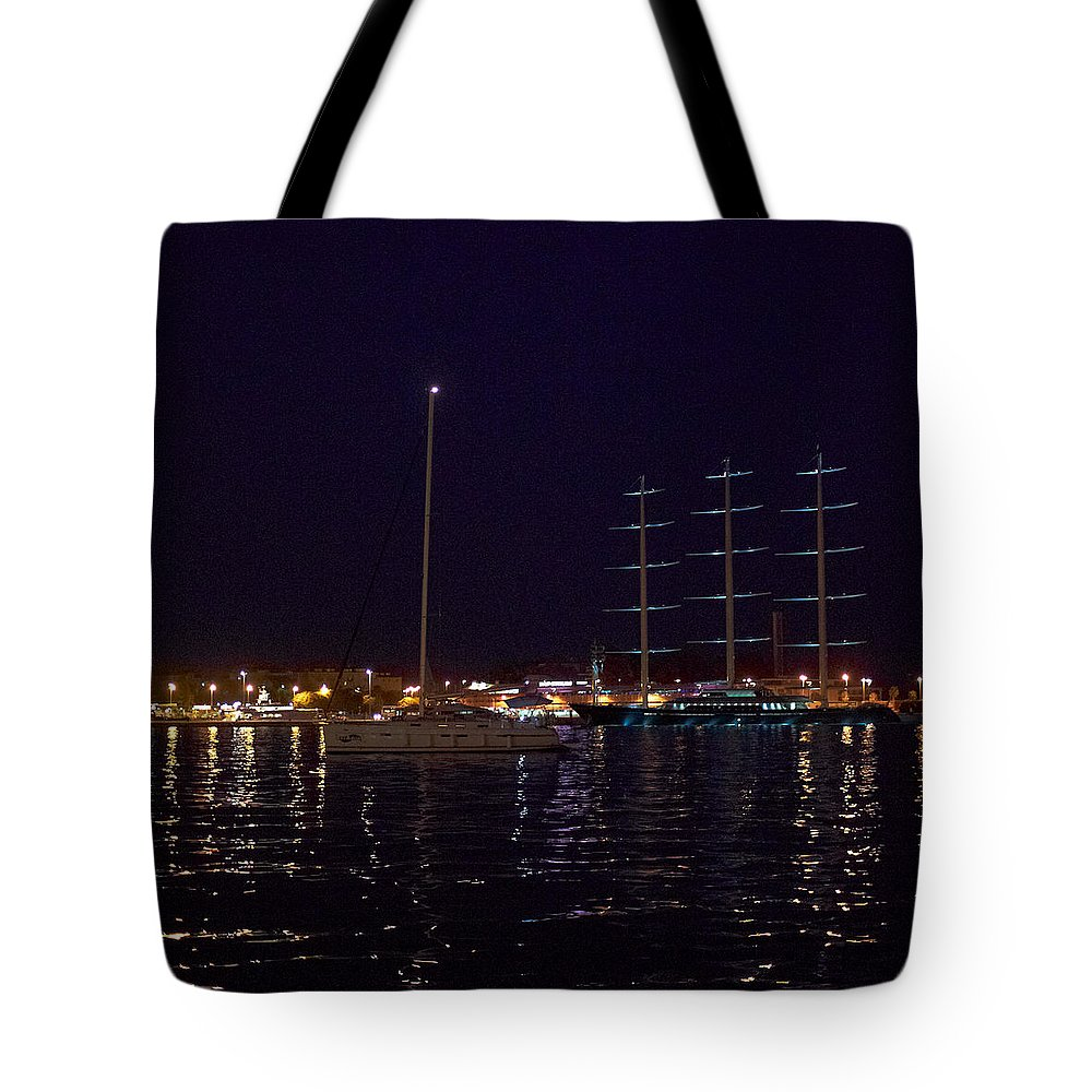 2012 Tote Bag featuring the photograph Sailboat And Maltese Hawk by Jouko Lehto