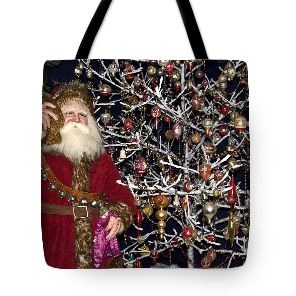 Santa Claus Figure Holding Teddy Tote Bag featuring the photograph Santa Claus by Sally Weigand