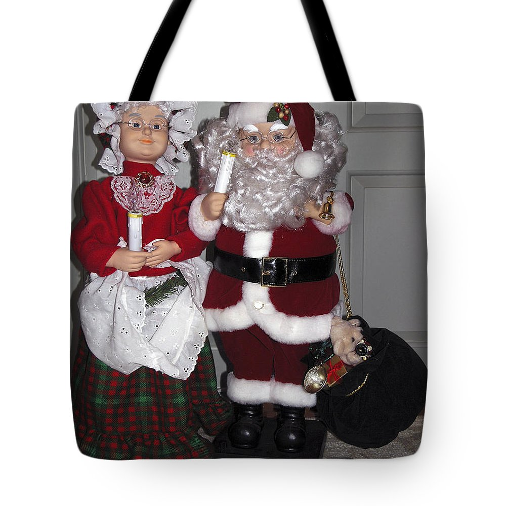 Mr. And Mrs. Santa Figures Tote Bag featuring the photograph Santa Couple by Sally Weigand