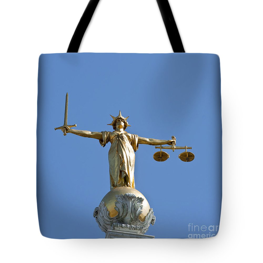 2011 Tote Bag featuring the photograph Scales Of Justice by Andrew Michael