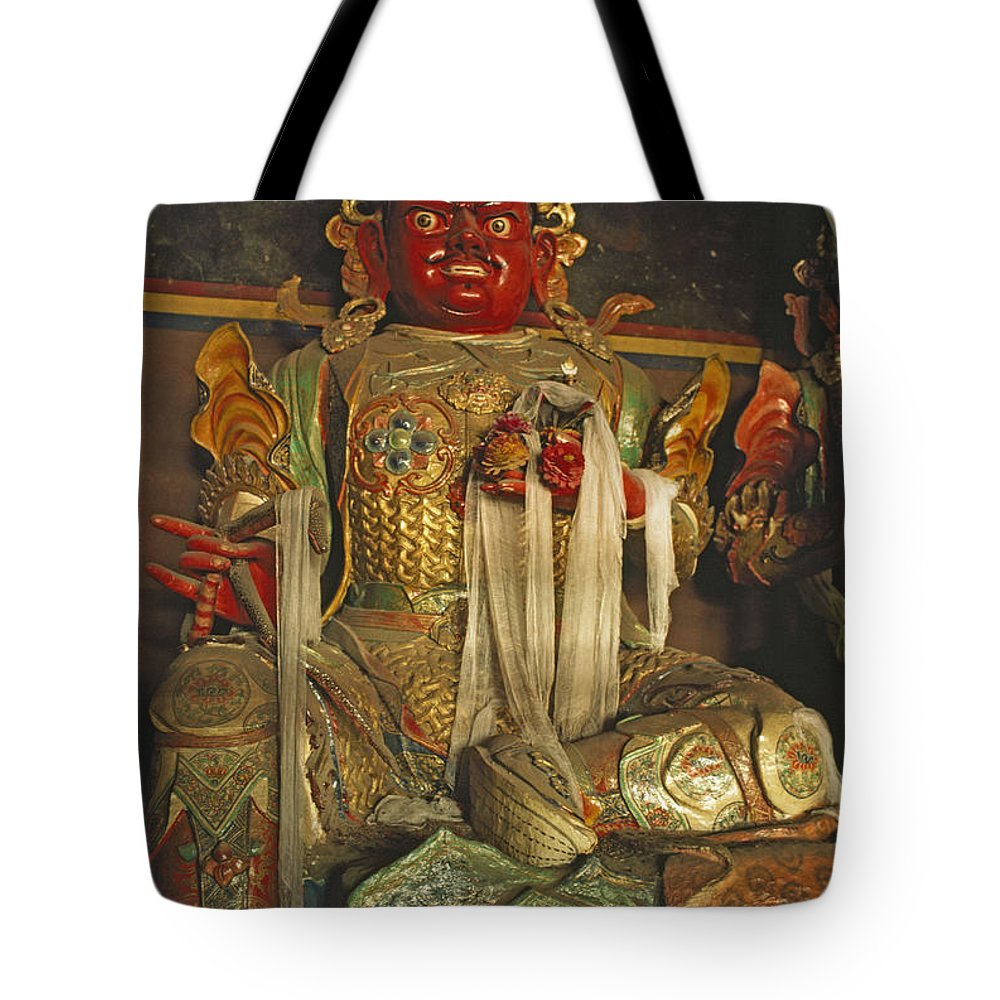 Tibetan Buddhism Tote Bag featuring the photograph Sculpture Of Wrathful Protective Deity by Gordon Wiltsie