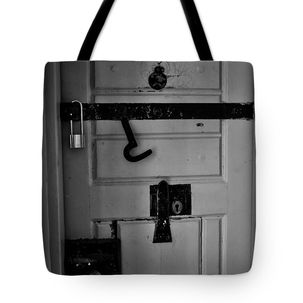 2012 Tote Bag featuring the photograph Secure by Jouko Lehto