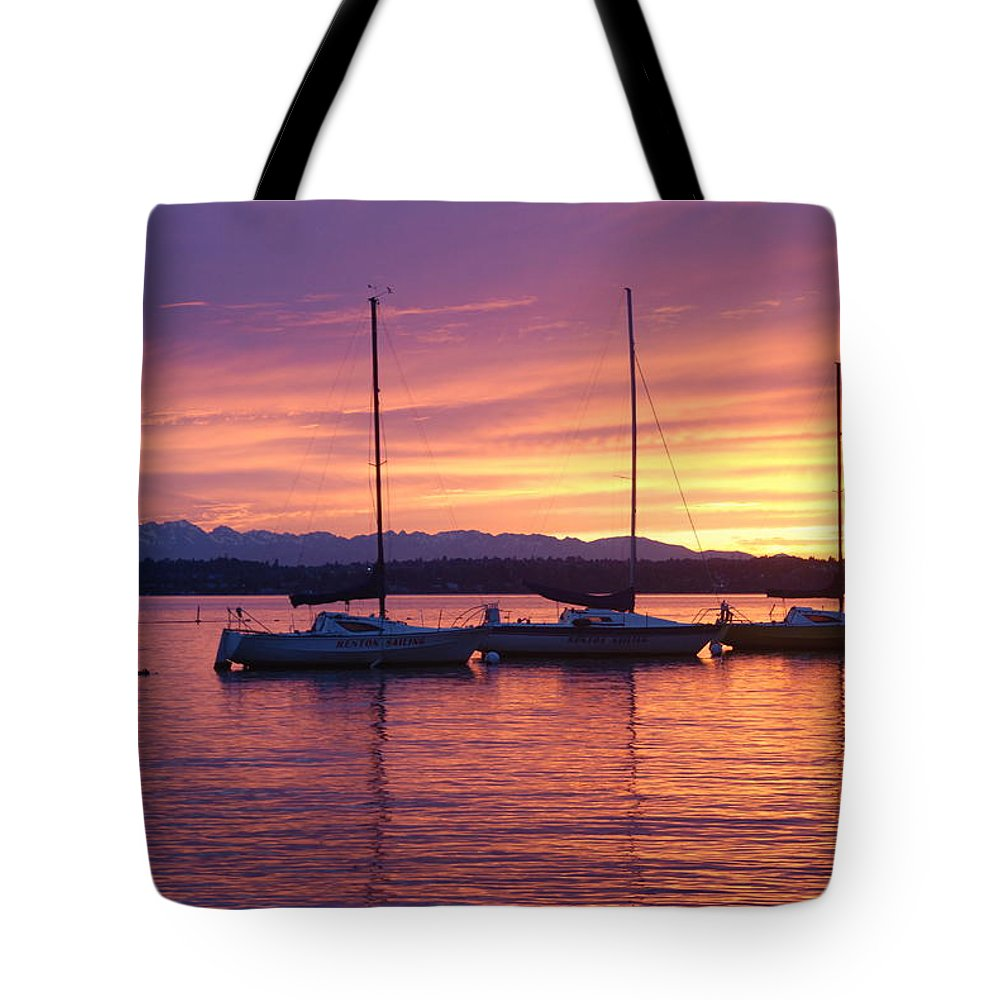 Sunset Tote Bag featuring the photograph Serene Sunset by Michael Merry