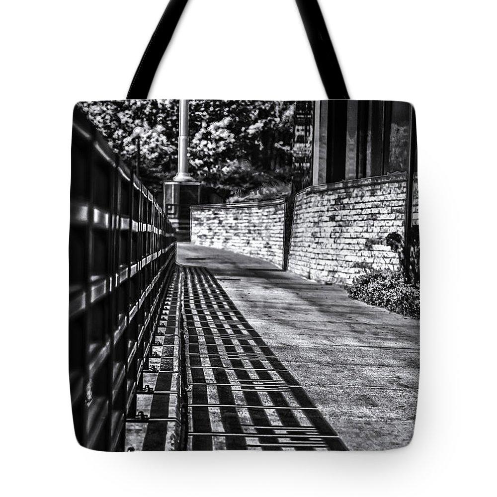 Rail Walk Cement Stone Brick Railing Sidewalk Path Tote Bag featuring the photograph Shadow Walk by Tom Gort