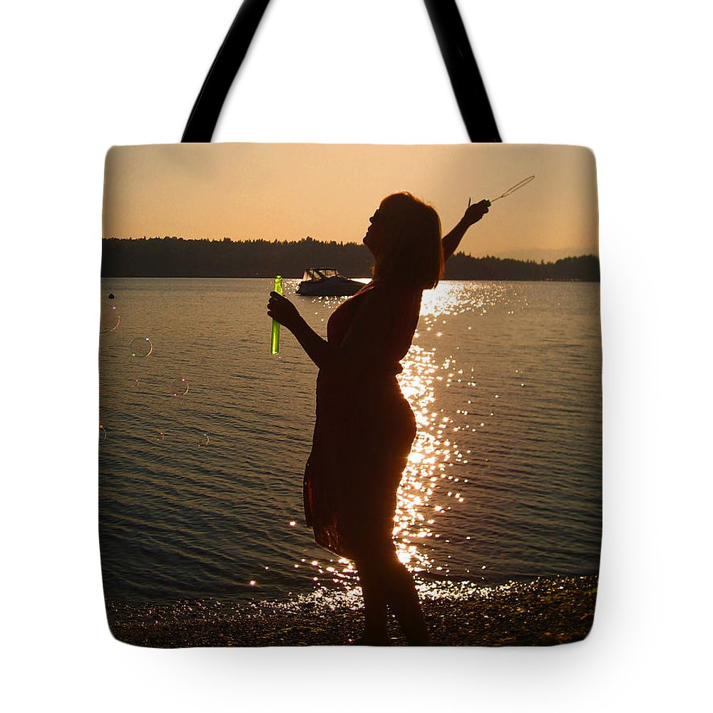 Sunset Tote Bag featuring the photograph She Blows Bubbles by Kym Backland