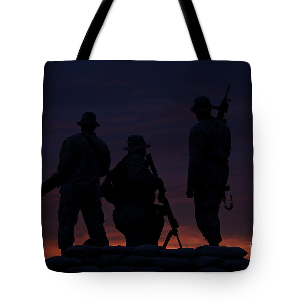 Marine Tote Bag featuring the photograph Silhouette Of U.s Marines On A Bunker by Terry Moore