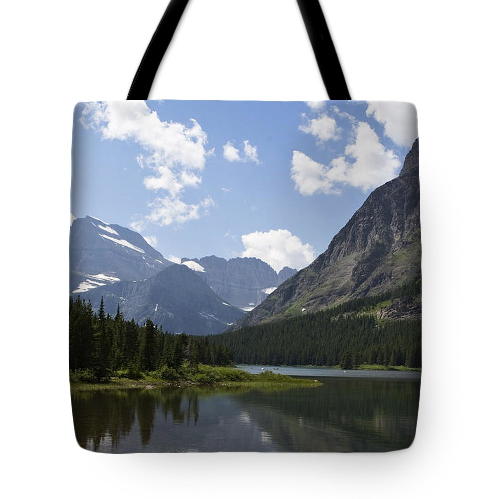 Swiftcurrent Lake Tote Bag featuring the photograph Sinopah Reflected by Lorraine Devon Wilke
