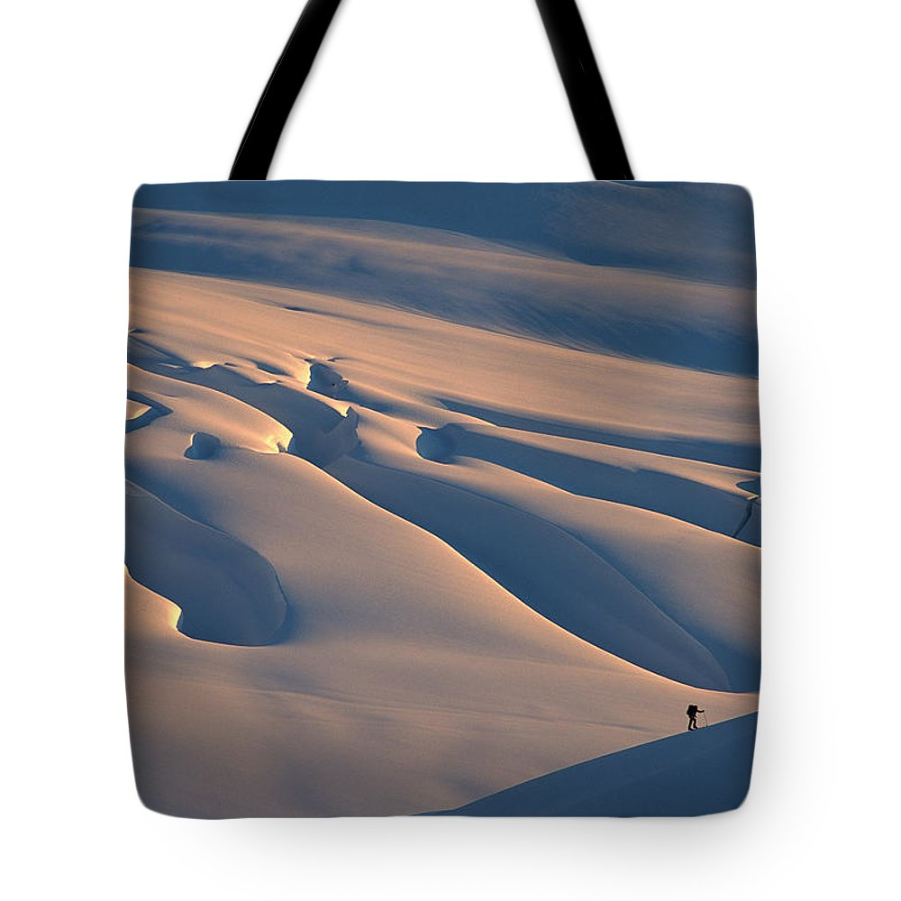 Cold Tote Bag featuring the photograph Skier And Crevasse Patterns At Sunset by Colin Monteath
