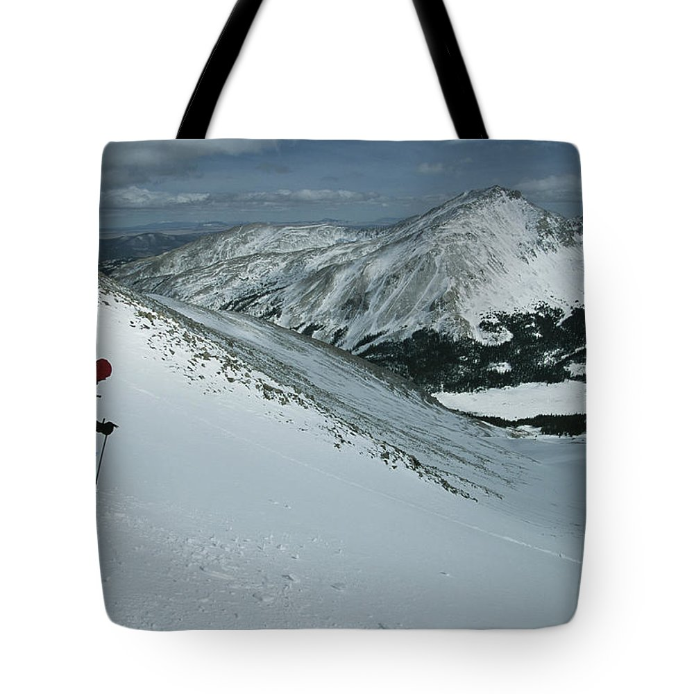 Model Released Photography Tote Bag featuring the photograph Skier Phil Atkinson Begins His Descent by Tim Laman