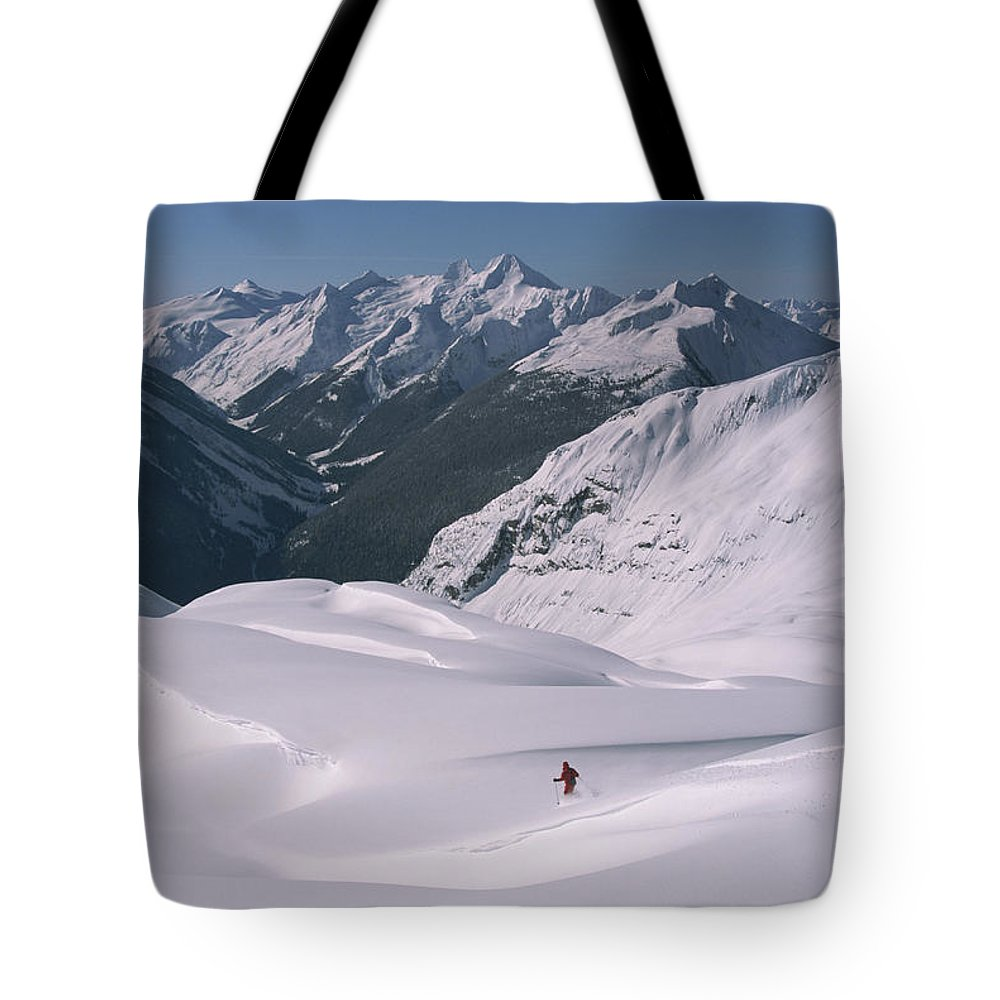 Model Released Photography Tote Bag featuring the photograph Skier Phil Atkinson Heads Down Mount by Tim Laman