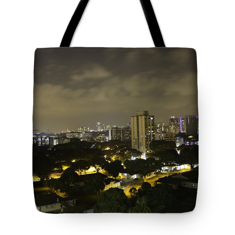 Action Tote Bag featuring the photograph Skyline Of A Part Of Singapore At Night by Ashish Agarwal