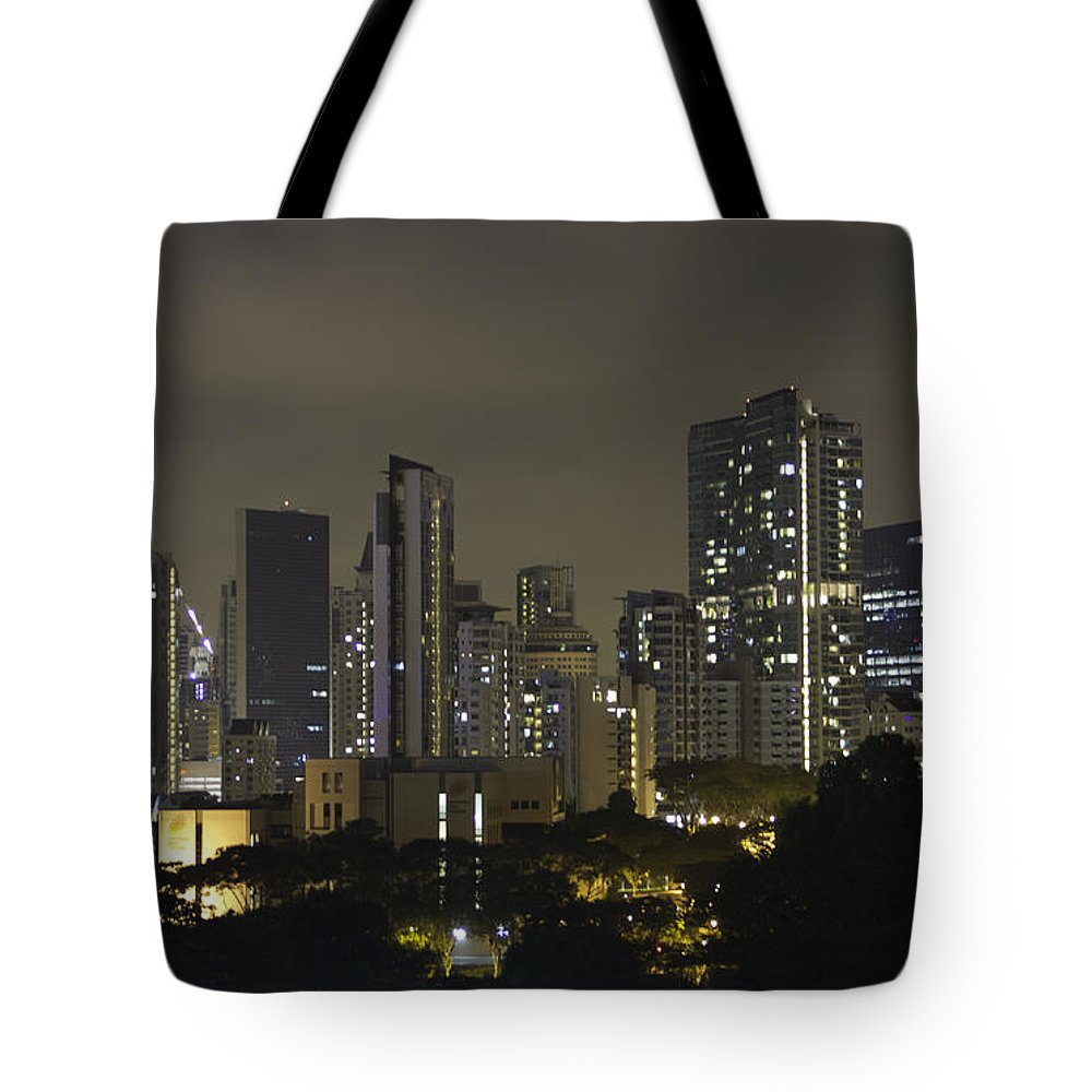 Action Tote Bag featuring the photograph Skyline Of Singapore At Night As Seen From An Apartment Complex by Ashish Agarwal