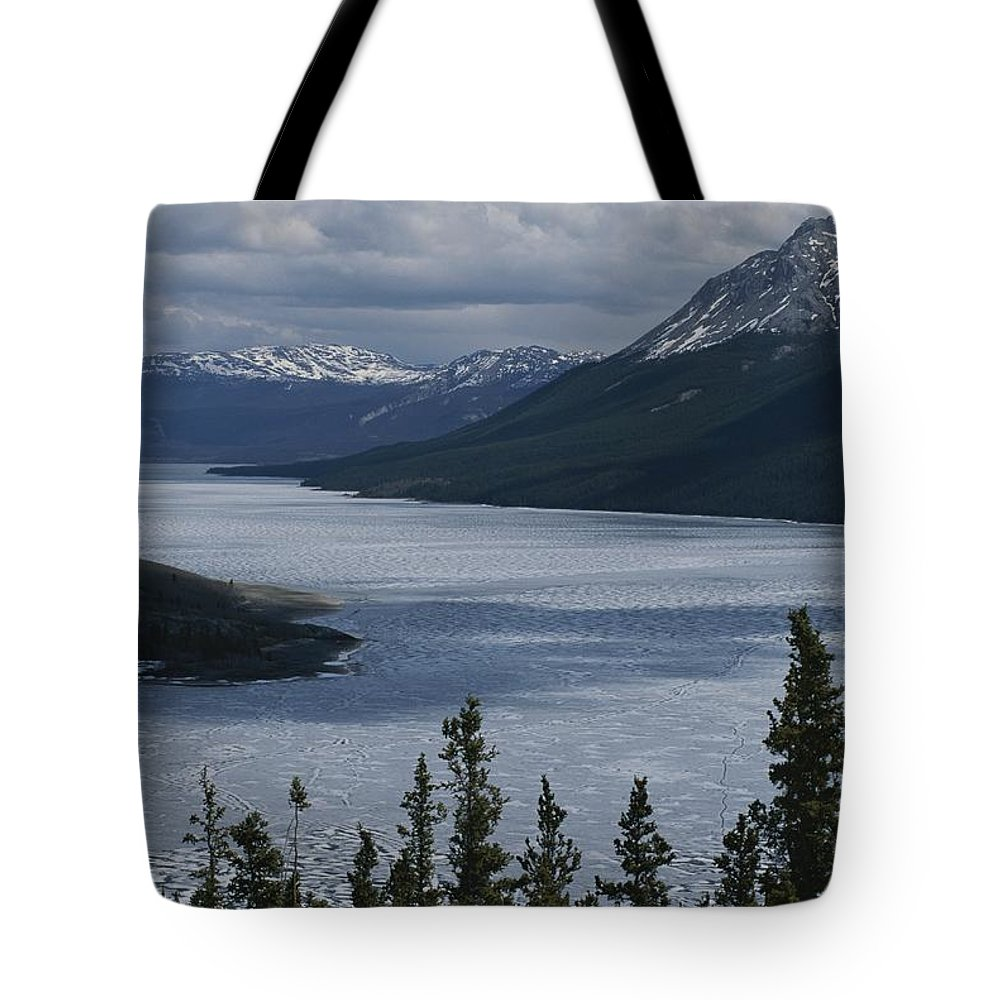 North America Tote Bag featuring the photograph Snow-capped Moutains Rise by George F. Mobley