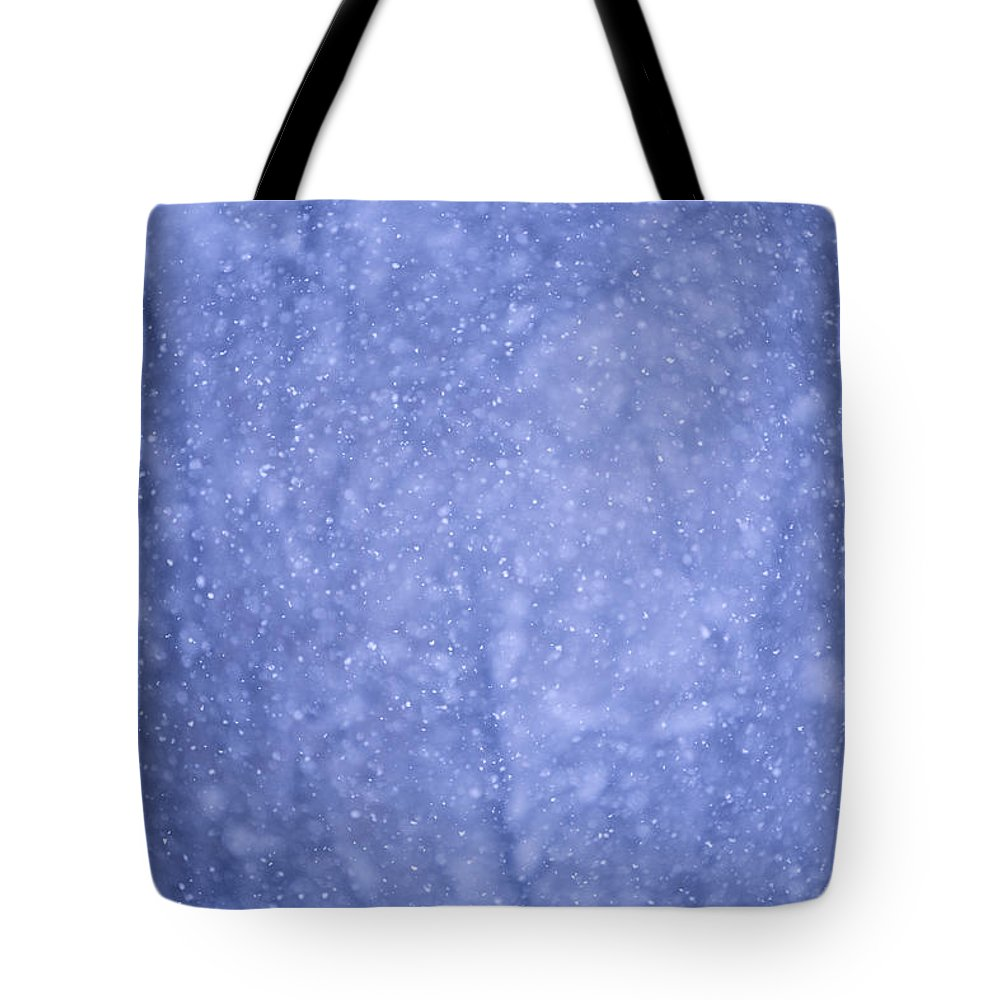 Snow Tote Bag featuring the photograph Snow Falling In The Forest by John Burcham