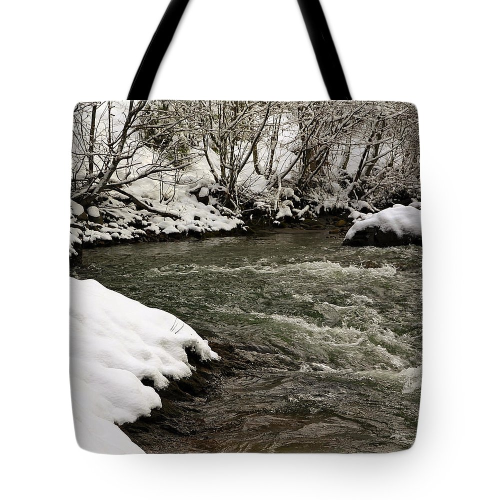 Snow Tote Bag featuring the photograph Snowy Mountain River by Steve McKinzie