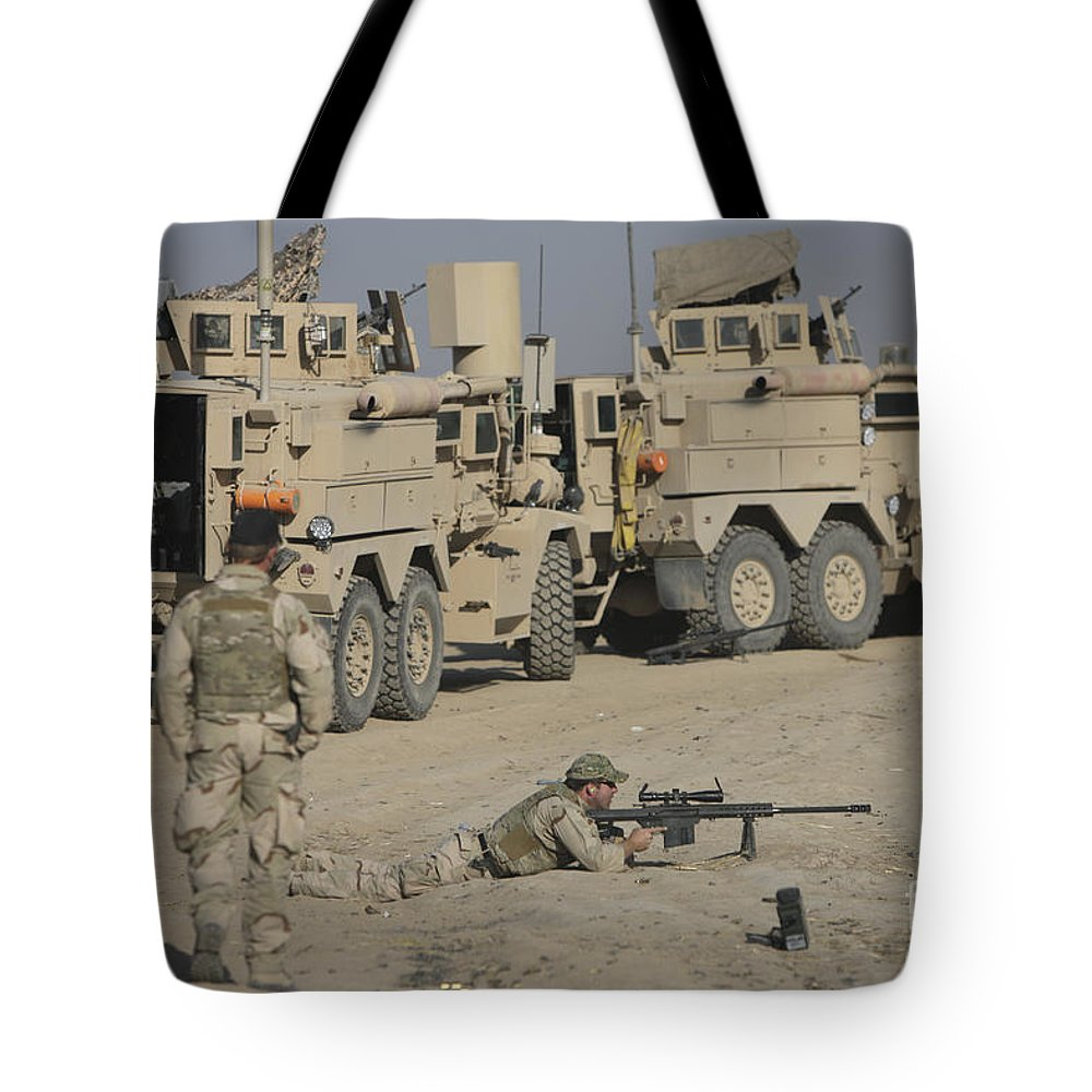 Vehicle Tote Bag featuring the photograph Soldier Fires A Barrett M82a1 Rifle by Terry Moore