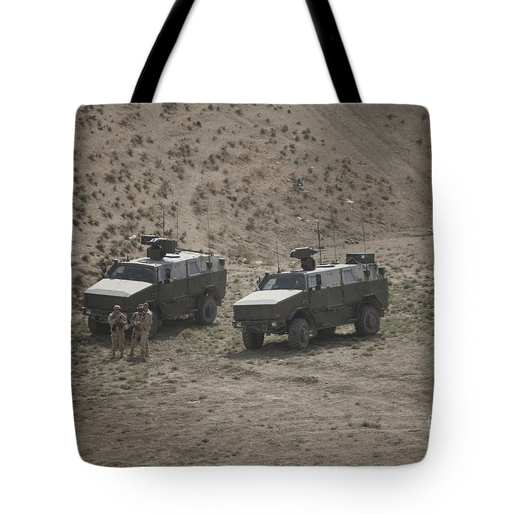 Mrap Tote Bag featuring the photograph Soldiers Stand Outside Their German Atf by Terry Moore