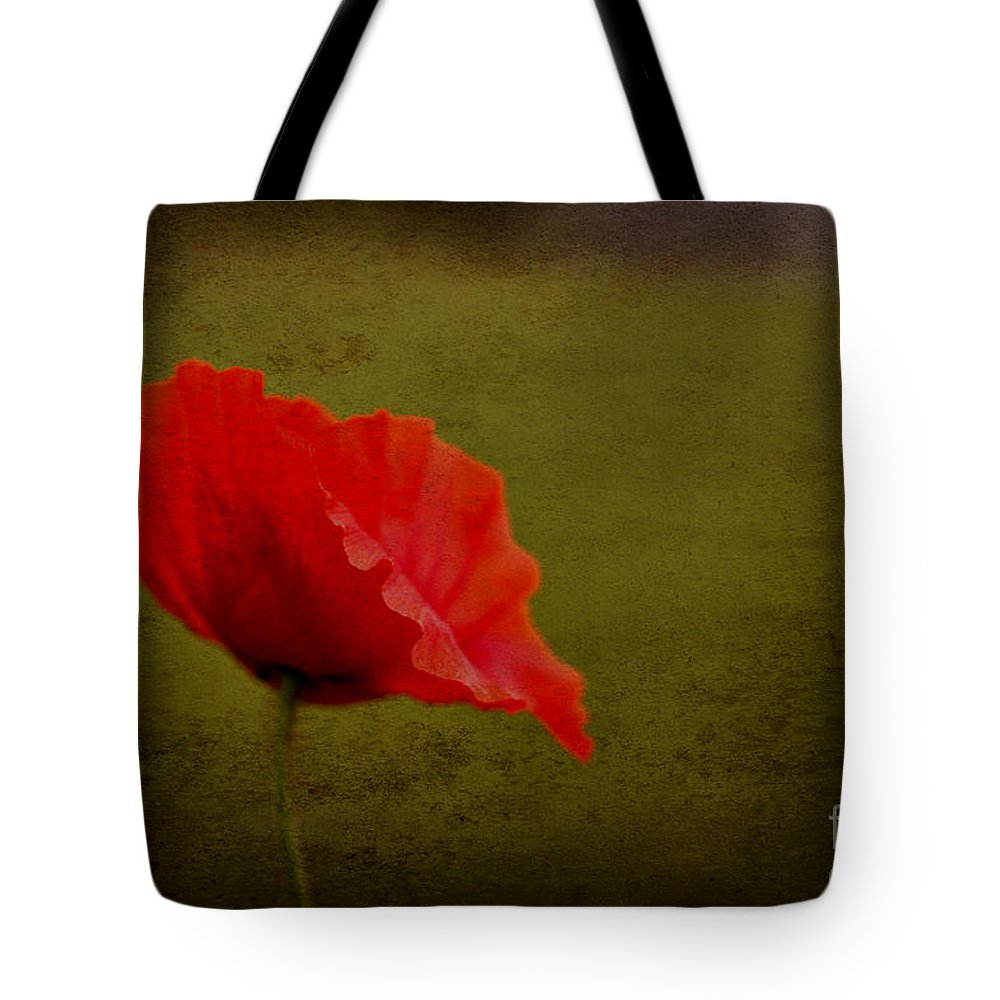 Poppies Tote Bag featuring the photograph Solitary Poppy. by Clare Bambers