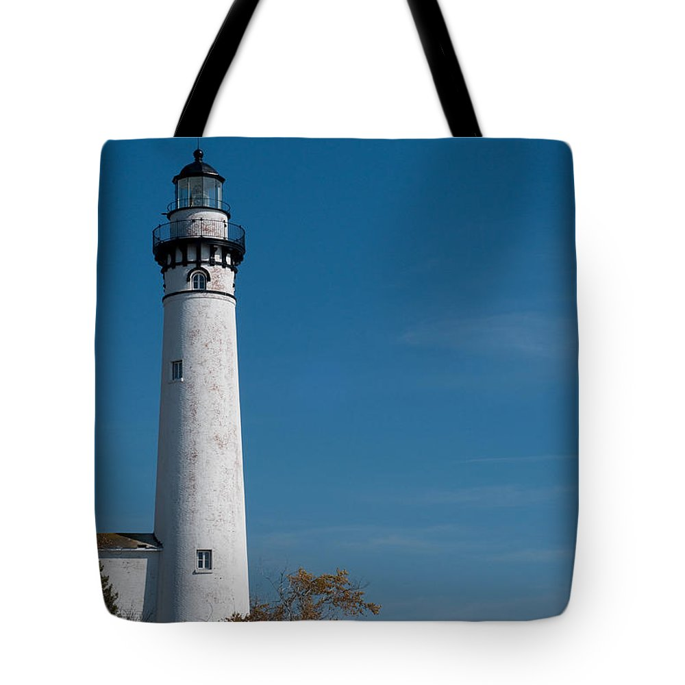 Lighthouse Tote Bag featuring the photograph South Manitou Island Lighthouse by David Arment