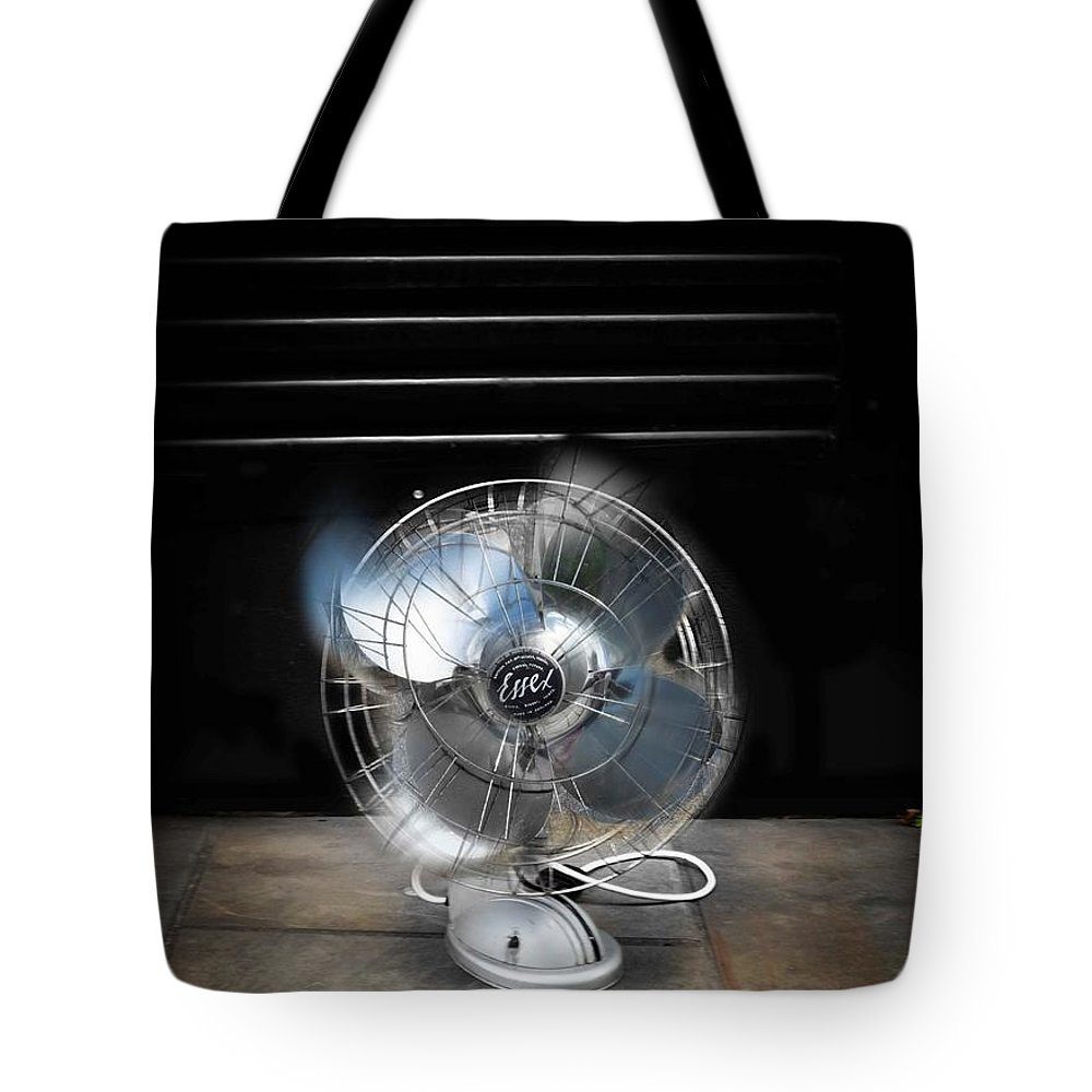 Harvest Tote Bag featuring the photograph Spin by Charles Stuart