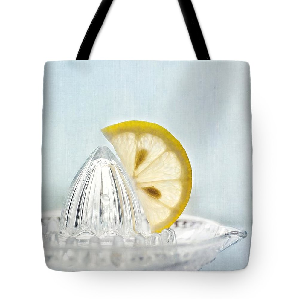 Lemon Tote Bag featuring the photograph Still Life With A Half Slice Of Lemon by Priska Wettstein