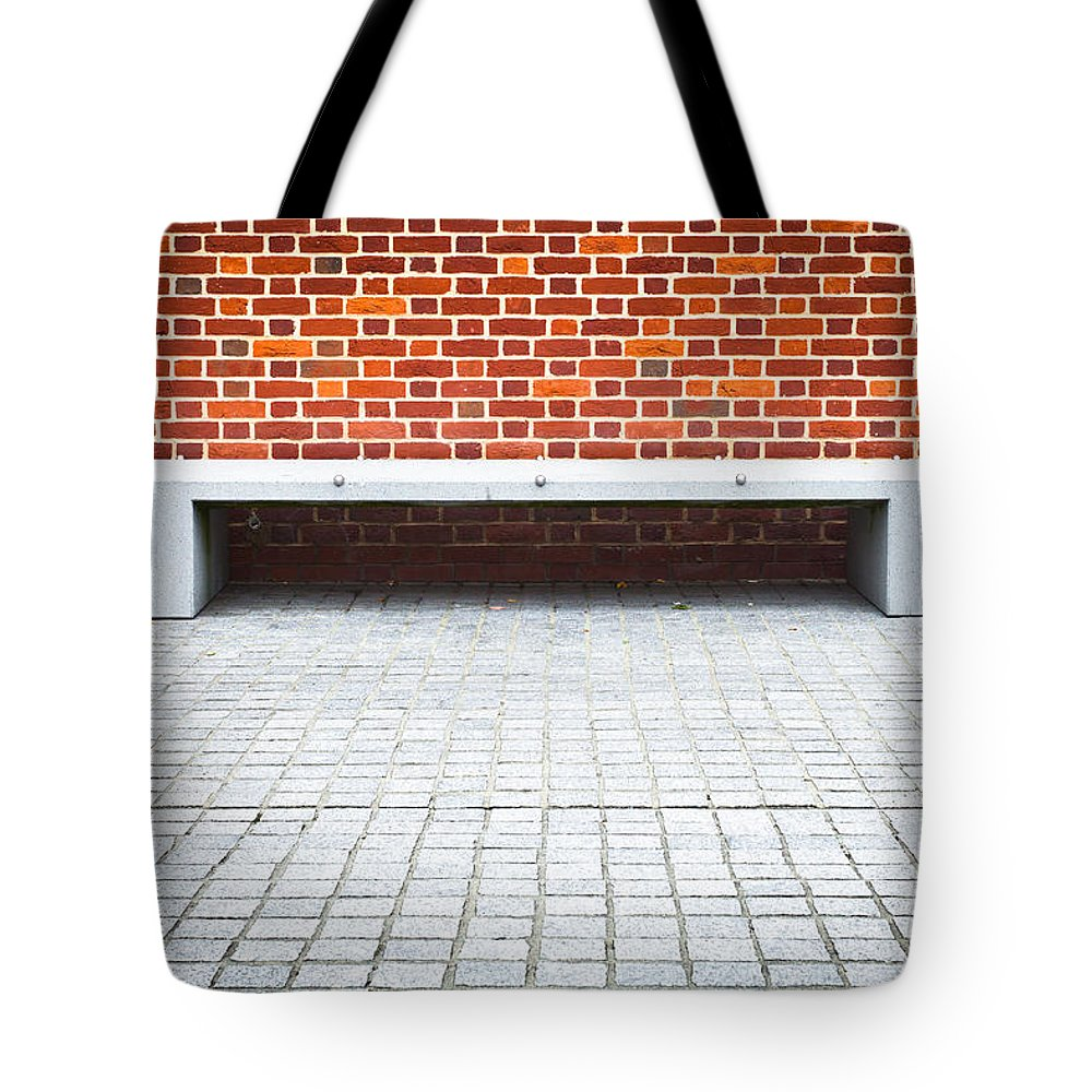 Abstracts Tote Bag featuring the photograph Stone Bench by Tom Gowanlock