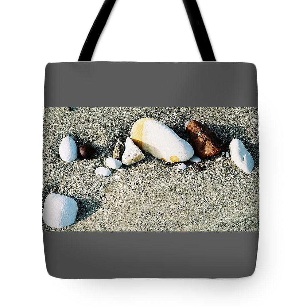 Beach Art Still Life Feng Shui Outdoors Meditation Beach Stones Stock Shot Yorkshire Travel Nature In Situ Minimalism Metal Frame Suggested Canvas Print Poster Print Wood Print Available On Greeting Cards Get Well Cards Pouches Mugs Phone Cases Tote Bags Throw Pillows T Shirts Duvet Covers Weekender Tote Bags And Shower Curtains Tote Bag featuring the photograph Stones On The Beach by Marcus Dagan