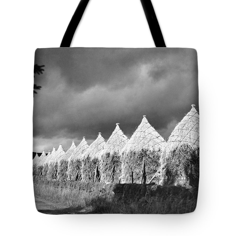perthshire Tote Bag featuring the photograph Storm Light On Grain Stacks Not Far by Maynard Owen Williams