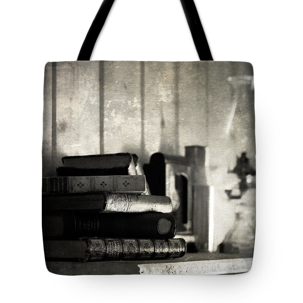 Books Tote Bag featuring the photograph Story To Sleep by The Artist Project
