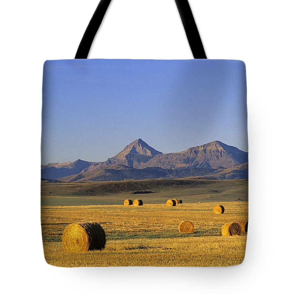 Countryside Tote Bag featuring the photograph Straw Bales, Pincher Creek, Alberta by John Sylvester