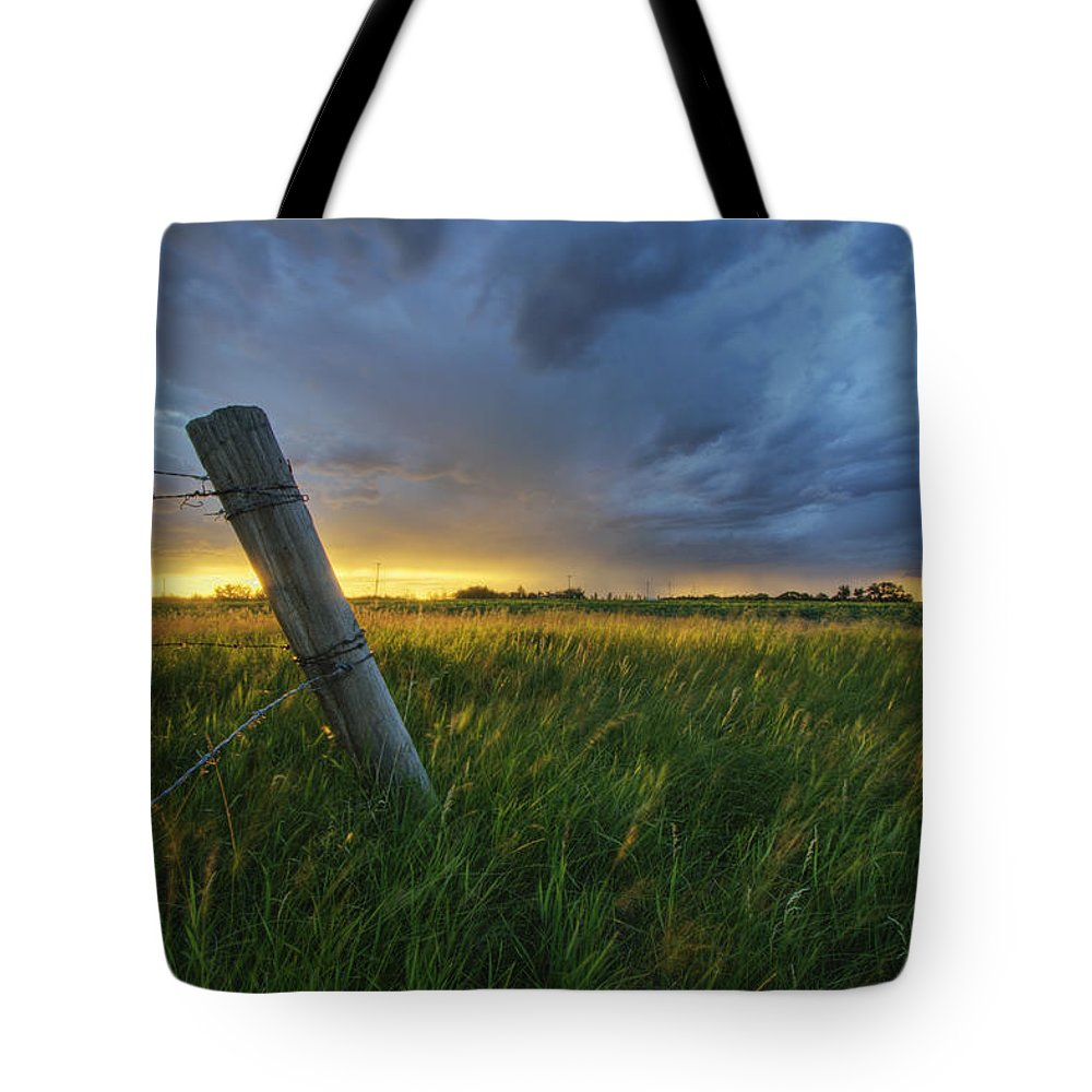 Alberta Tote Bag featuring the photograph Summer Thunderstorm And Fencepost by Dan Jurak