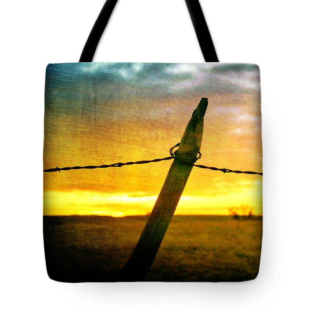 Sunrise Tote Bag featuring the photograph Sunrise Over The Prairie by Ellen Heaverlo