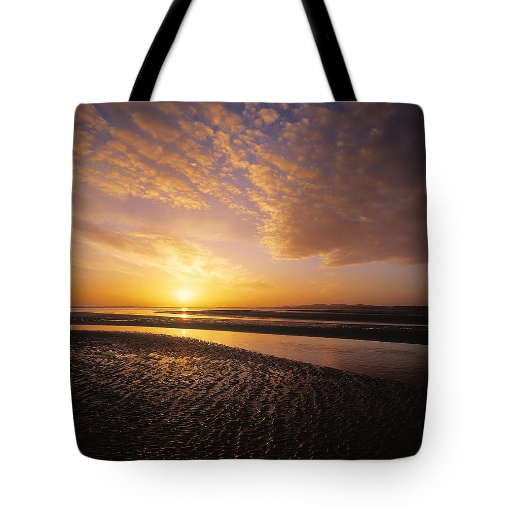 Beach Tote Bag featuring the photograph Sunrise, Sandymount Strand Dun by The Irish Image Collection