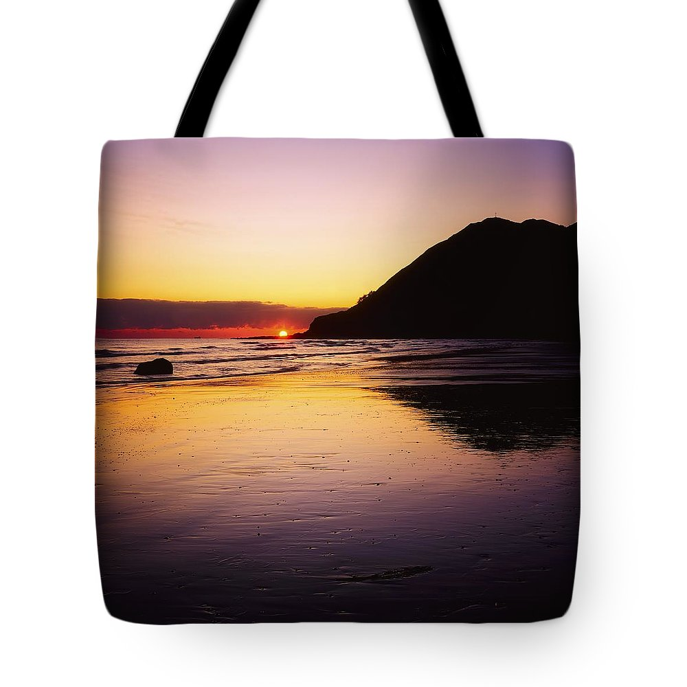 Beach Tote Bag featuring the photograph Sunset And Sea by The Irish Image Collection