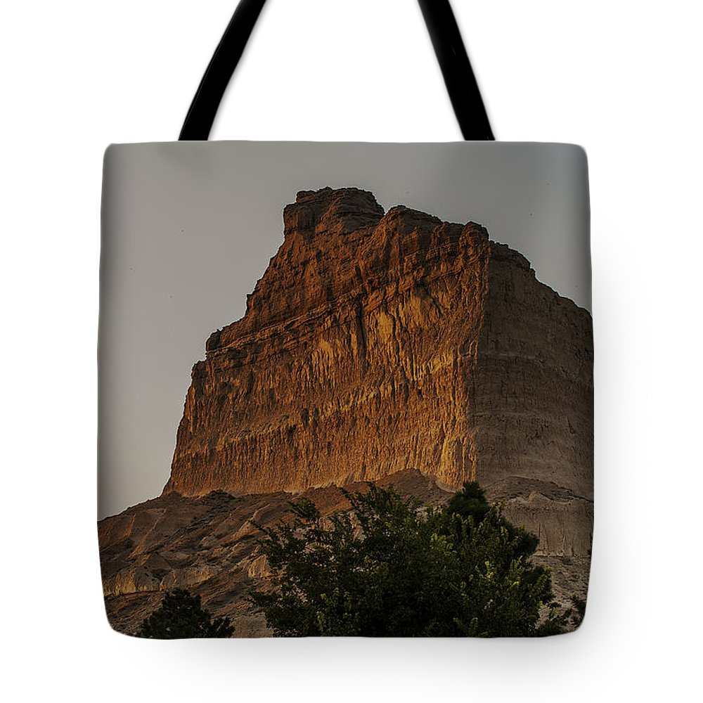 Scotts Bluff National Monument Tote Bag featuring the photograph Sunset In Western Nebraska by Edward Peterson