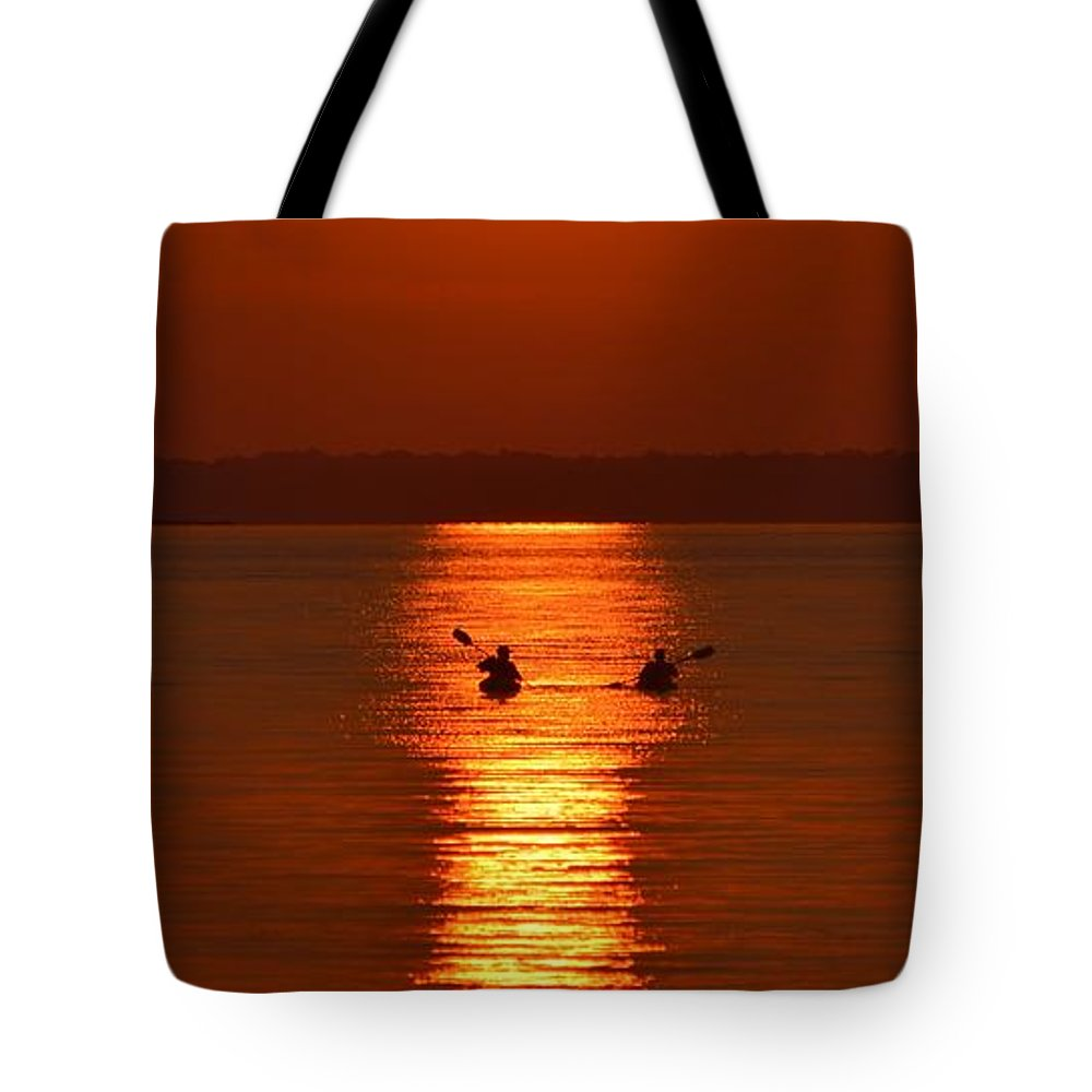 Golden Sunset Kayaks Bay Beach Calm Calmness Canoe Canoeing Clouds Coast Dark Dawn Dusk Escape Evening Fun Golden Horizon Kayak Kayaking Leisure Lifestyle Man Ocean Orange Paddle Person Relaxation Rest Ripples Scenery Scenic Sea Serenity Shore Silhouette Solitude Sports Summer Sunset Tranquil Tranquility Tropical Tropics Vacation Water Waves Tote Bag featuring the photograph Sunset Kayakers by William Bartholomew