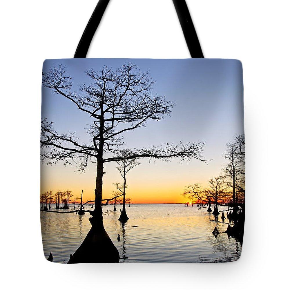 Mattamuskeet Tote Bag featuring the photograph Sunset On Lake Mattamuskeet by Rob Travis