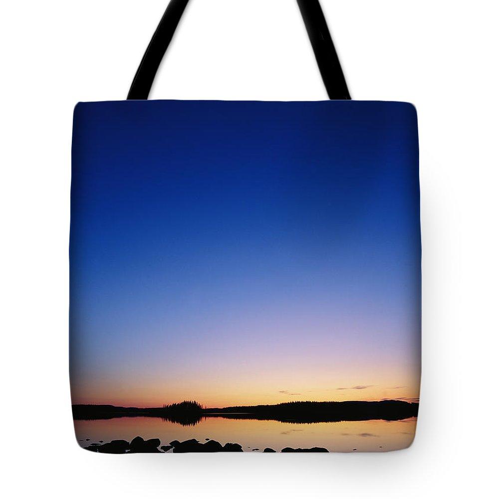 Dalecarlia Reservoir Tote Bag featuring the photograph Sunset Over Bjorksjon by Mattias Klum