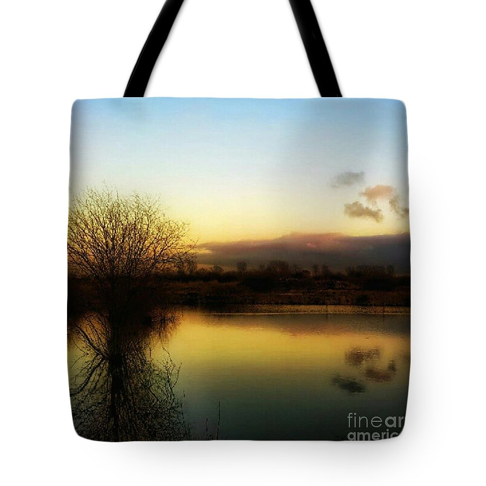 Laake Tote Bag featuring the photograph Sunset Over The Lake by Isabella F Abbie Shores